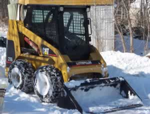Snow Removal with our CAT 216 Skidsteer